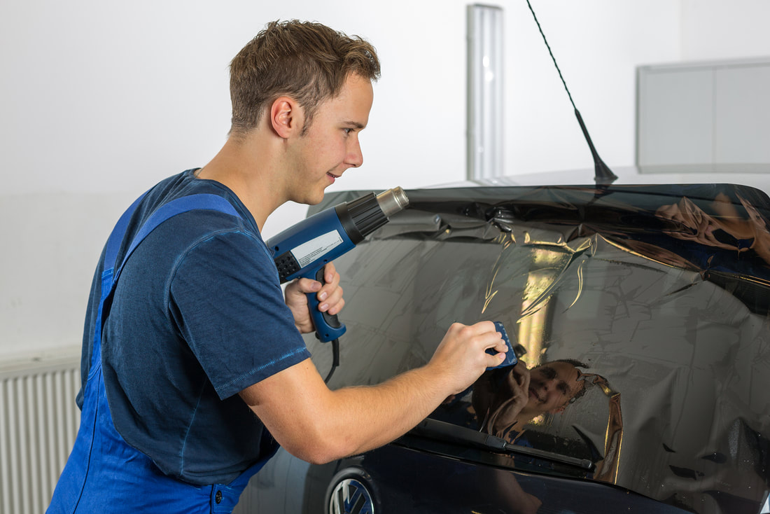 Picture of window tinting technician
